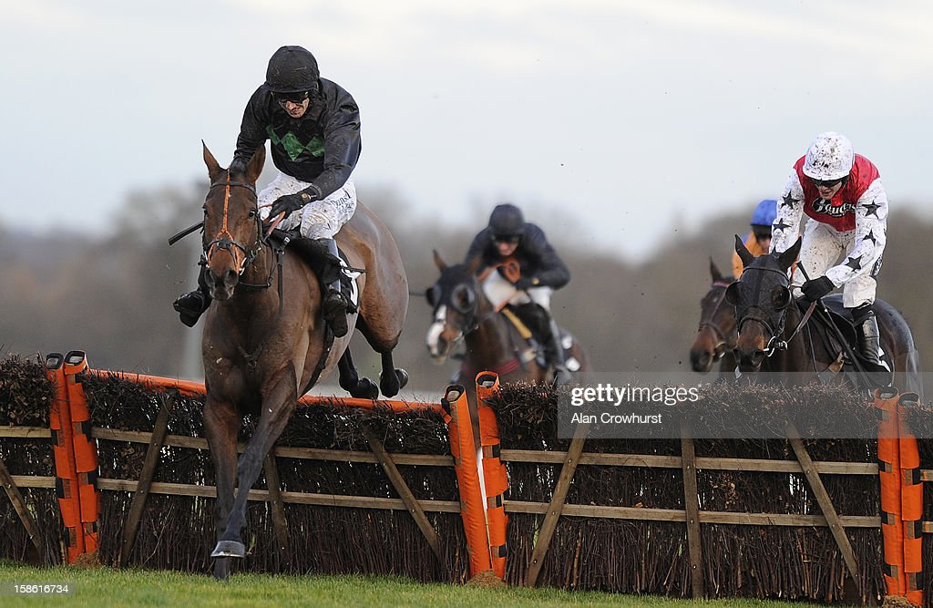 <a gi-track='captionPersonalityLinkClicked' href=/galleries/search?phrase=Paddy+Brennan&family=editorial&specificpeople=241422 ng-click='$event.stopPropagation()'>Paddy Brennan</a> riding Farmer Matt clear the last to win The Barclays Handicap Hurdle Race at Ascot racecourse on December 21, 2012 in Ascot, England.