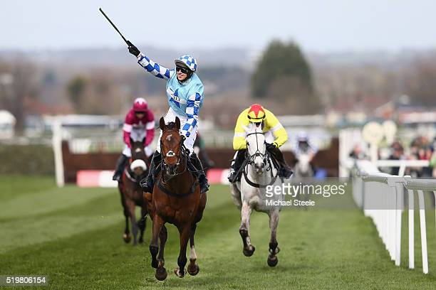 Paddy Brennan riding God's Own celebrates victory from Harry Skelton riding Al Ferof in the JLT Melling steeplechase at Aintree Racecourse on April 8...