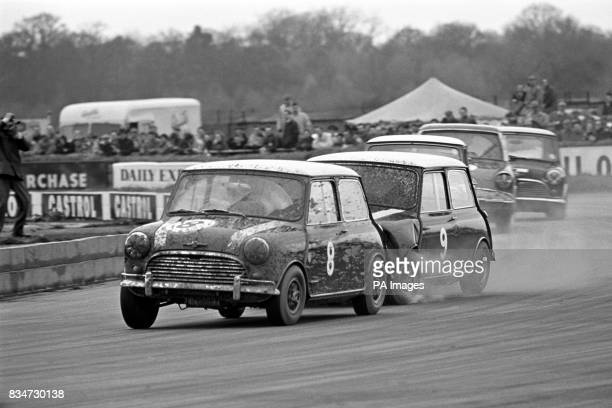 Paddy Hopkirk in his Morris Mini fends off late breaking team mate John Fitzpatrick in their Cooper Car Company entered cars Fitzpatrick has already...