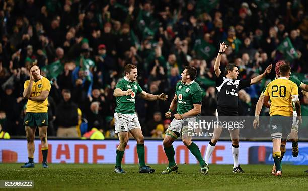 Paddy Jackson of Ireland and CJ Stander of Ireland celebrate as Referee Jerome Garces awards Ireland a penalty to finish the game during the...