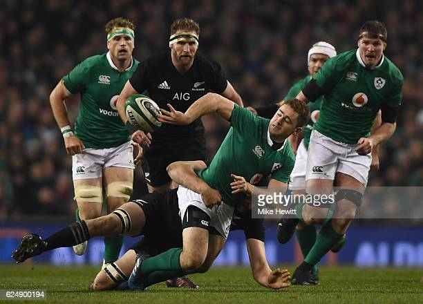 Paddy Jackson of Ireland gets the ball away in the tackle during the International Friendly between Ireland and New Zealand at Aviva Stadium on...