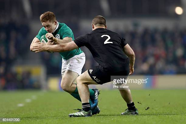 Paddy Jackson of Ireland is tackled by Dane Coles of New Zealand during the international rugby match between Ireland and the New Zealand All Blacks...