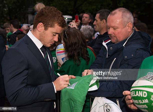 Paddy Jackson signs a shirt as the Ireland squad are welcomed to the RWC welcome ceremony at on September 21 2015 in Burton upon Trent England