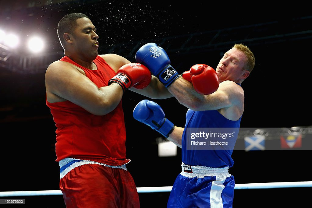 Paddy Junior Leuii of Samoa (red) in action against Paul Schafer of South Africa in the Men's Super Heavy +91kg preliminaries at Scottish Exhibition And Conference Centre during day two of the Glasgow 2014 Commonwealth Games on July 25, 2014 in Glasgow, United Kingdom.