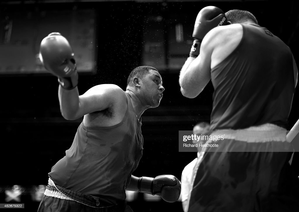 Paddy Junior Leuii of Samoa in action against Paul Schafer of South Africa in the Men's Super Heavy +91kg preliminaries at Scottish Exhibition And Conference Centre during day two of the Glasgow 2014 Commonwealth Games on July 25, 2014 in Glasgow, United Kingdom.