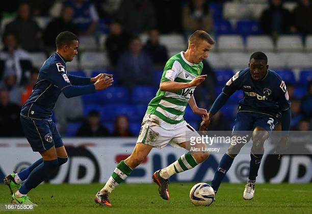 Paddy Madden of Yeovil Town takes on Glenn Belezika and Connor Brown of Oldham Athletic during the npower League One match between Oldham Athletic...