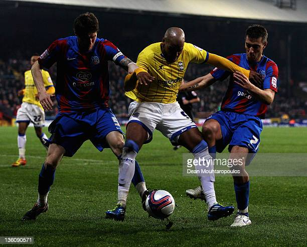 Paddy McCarthy and darren Ambrose of Palace and Marlon King of Birmingham battle for the ball during the npower Championship match between Crystal...