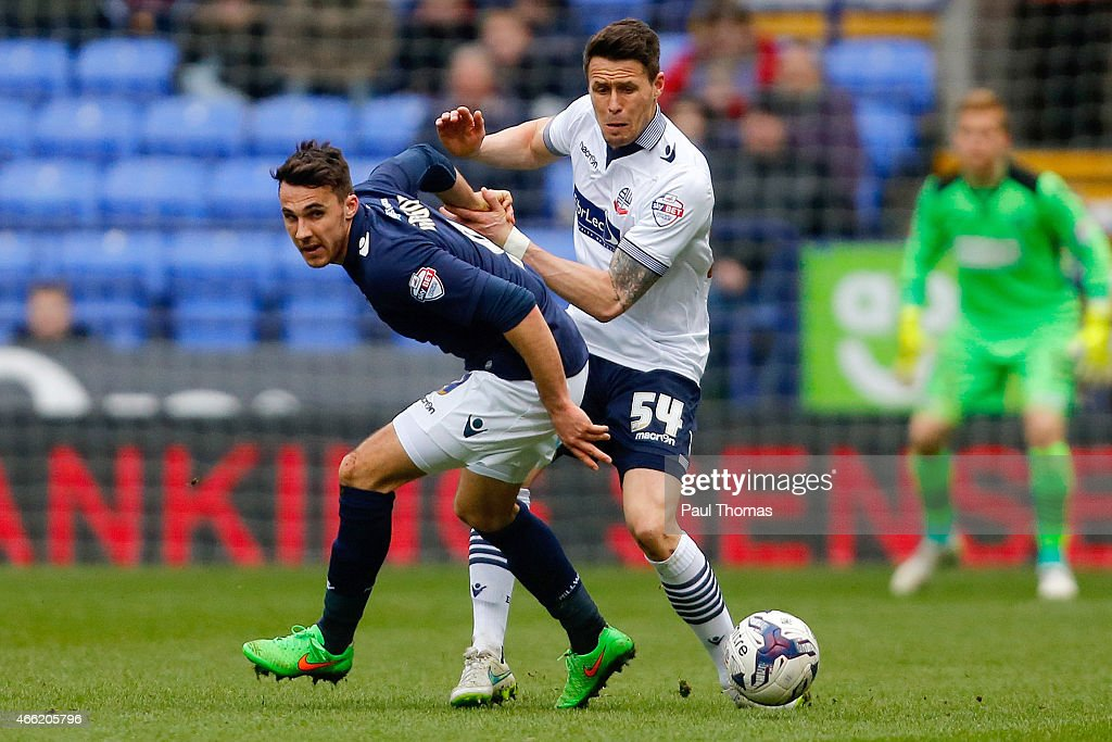 Paddy McCarthy (R) of Bolton in action with Lee Gregory of Millwall during the Sky Bet Championship match between Bolton Wanderers and Millwall at the Macron Stadium on March 14, 2015 in Bolton, England.