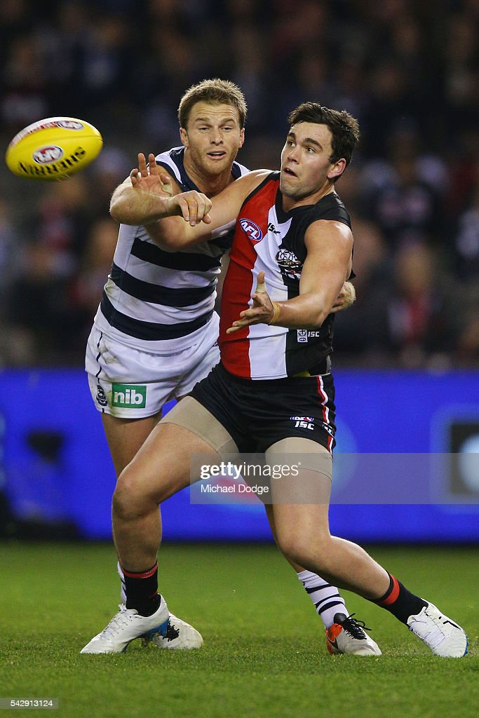 Paddy McCartin of the Saints (R) and Lachie Henderson of the Cats compete for the ball during the round 14 AFL match between the St Kilda Saints and the Geelong Cats at Etihad Stadium on June 25, 2016 in Melbourne, Australia.