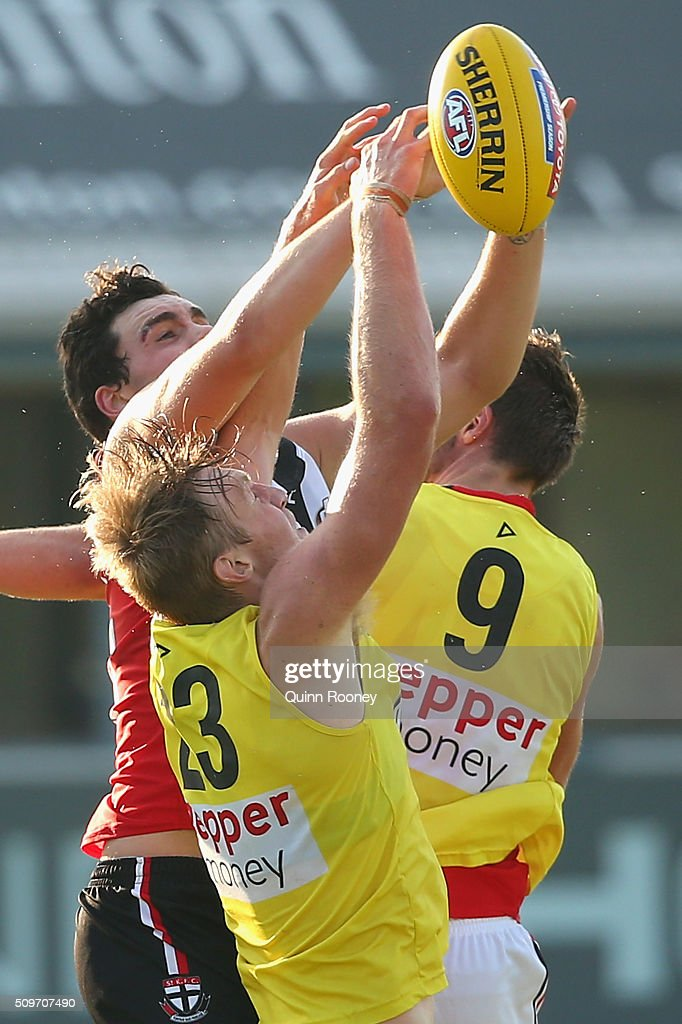 Paddy McCartin of the Saints attempts to mark over the top of Hugh Goddard during the St Kilda Saints AFL Intra-Club Match at Trevor Barker Beach Oval on February 12, 2016 in Melbourne, Australia.