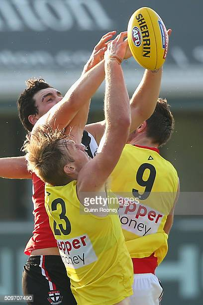 Paddy McCartin of the Saints attempts to mark over the top of Hugh Goddard during the St Kilda Saints AFL IntraClub Match at Trevor Barker Beach Oval...