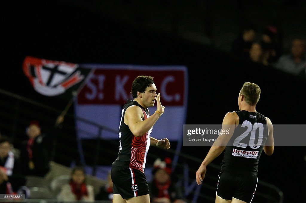 Paddy McCartin of the Saints celebrates a goal with team mate David Armitage during the round 10 AFL match between the St Kilda Saints and the Fremantle Dockers at Etihad Stadium on May 28, 2016 in Melbourne, Australia.