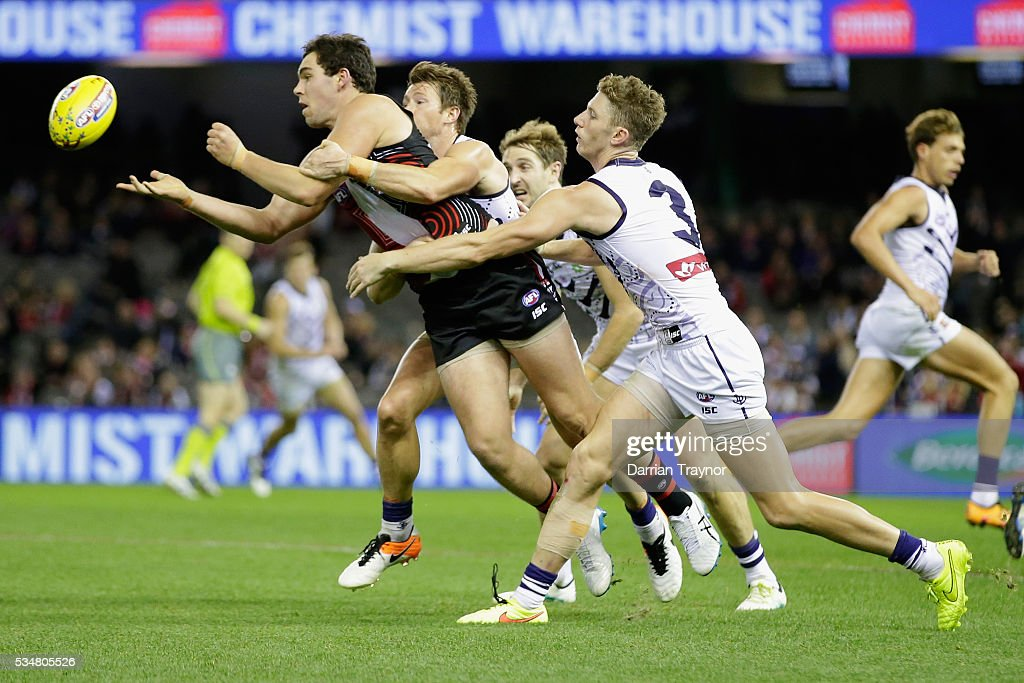 Paddy McCartin of the Saints handballs during the round 10 AFL match between the St Kilda Saints and the Fremantle Dockers at Etihad Stadium on May 28, 2016 in Melbourne, Australia.