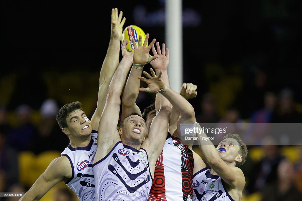 Paddy McCartin of the Saints jumps for the ball against Jonathon Griffin and Zac Dawson of the Dockers during the round 10 AFL match between the St Kilda Saints and the Fremantle Dockers at Etihad Stadium on May 28, 2016 in Melbourne, Australia.