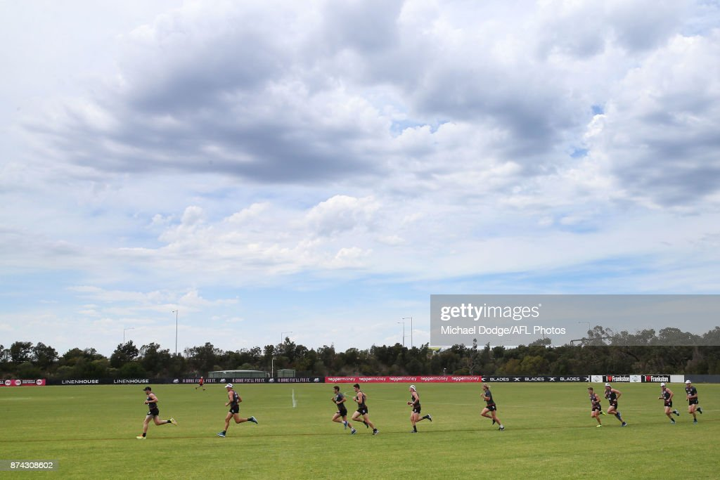 Paddy McCartin of the Saints leads teammates in a sprint around the oval during a St Kilda Saints AFL training session at Linen House Oval on November 15, 2017 in Melbourne, Australia.