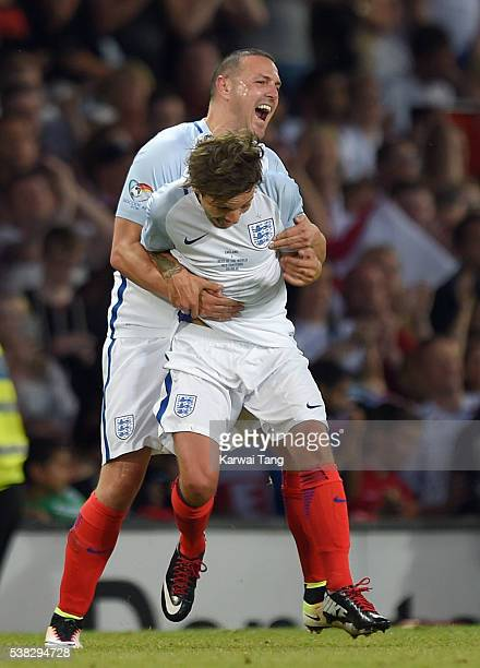 Paddy McGuinness and Louis Tomlinson celebrate after England beat Rest of the World during Soccer Aid 2016 at Old Trafford on June 5 2016 in...