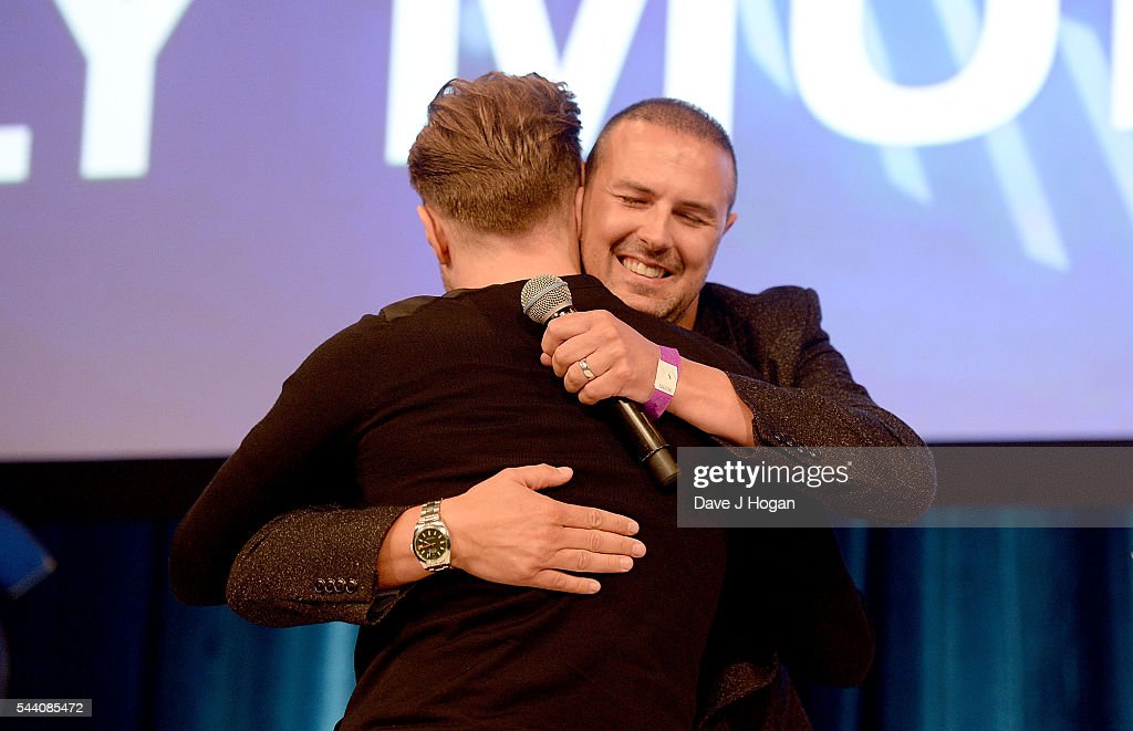 <a gi-track='captionPersonalityLinkClicked' href=/galleries/search?phrase=Paddy+McGuinness&family=editorial&specificpeople=4311027 ng-click='$event.stopPropagation()'>Paddy McGuinness</a> hugs <a gi-track='captionPersonalityLinkClicked' href=/galleries/search?phrase=Olly+Murs&family=editorial&specificpeople=6350751 ng-click='$event.stopPropagation()'>Olly Murs</a> on stage during the Nordoff Robbins O2 Silver Clef Awards on July 1, 2016 in London, United Kingdom.