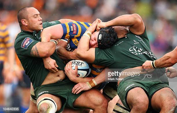 Paddy Ryan of Sydney Uni is tackled around the head during the Shute Shield Grand Final match between Randwick and Sydney University at Concord Oval...