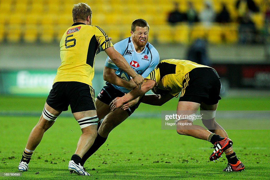 Paddy Ryan of the Waratahs is tackled during the round eight Super Rugby match between the Hurricanes and the Waratahs at Westpac Stadium on April 6, 2013 in Wellington, New Zealand.