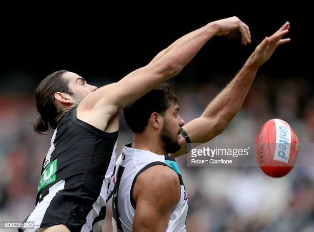 Paddy Ryder of the Power and Brodie Grundy of the Magpies compete for the ball during the round 14 AFL match between the Collingwood Magpies and the...