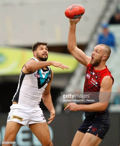 Paddy Ryder of the Power and Max Gawn of the Demons compete in a ruck contest during the 2017 AFL round 18 match between the Melbourne Demons and the...
