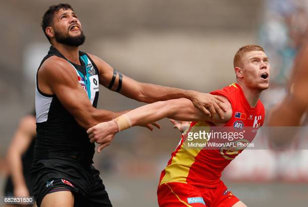 Paddy Ryder of the Power and Peter Wright of the Suns compete in a ruck contest during the 2017 AFL round 08 match between the Gold Coast Suns and...