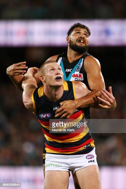 Paddy Ryder of the Power and Sam Jacobs of the Crows compete in the ruck during the round three AFL match between the Port Adelaide Power and the...