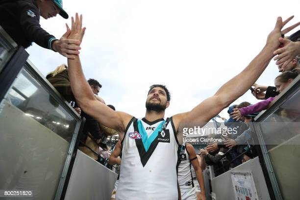 Paddy Ryder of the Power celebrates his 200th match and his teams win over the Magpies during the round 14 AFL match between the Collingwood Magpies...
