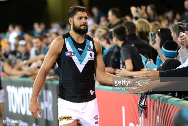 Paddy Ryder of the Power celebrates victory with fans after the round six AFL match between the Brisbane Lions and the Port Adelaide Power at The...