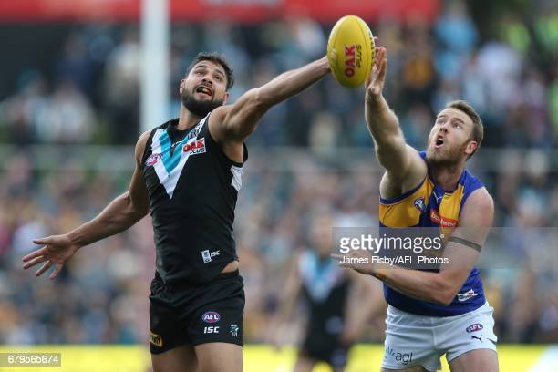 Paddy Ryder of the Power competes with Jonathan Giles of the Eagles during the 2017 AFL round 07 match between Port Adelaide Power and the West Coast...