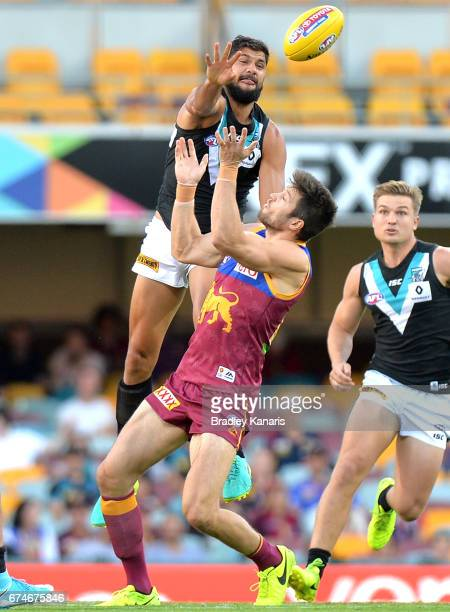Paddy Ryder of the Power gets above Stefan Martin of the Lions during the round six AFL match between the Brisbane Lions and the Port Adelaide Power...