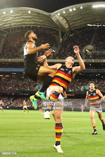 Paddy Ryder of the Power goes up to take a mark over Sam Jacobs of the Crows during the round three AFL match between the Port Adelaide Power and the...