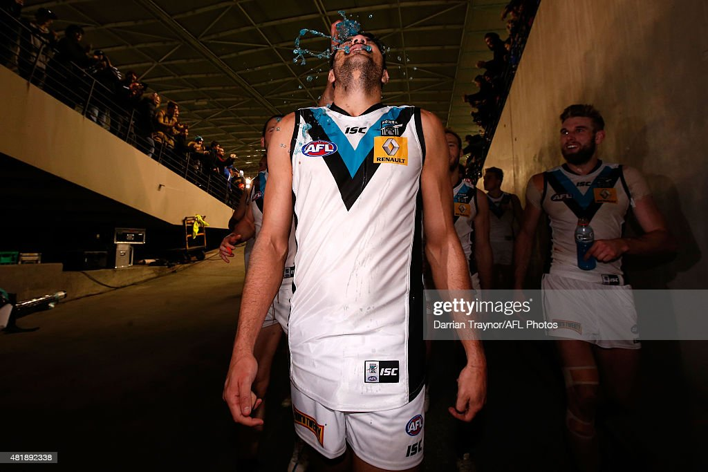 Paddy Ryder of the Power is showered in gatorade as he walks from the ground after the round 17 AFL match between the Essendon Bombers and the Port Adelaide Power at Etihad Stadium on July 25, 2015 in Melbourne, Australia.