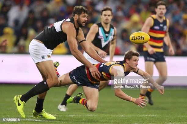 Paddy Ryder of the Power tackles Matt Crouch of the Crows during the 2017 AFL round 20 match between the Adelaide Crows and the Port Adelaide Power...