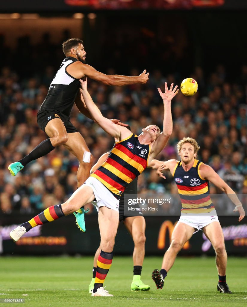 Paddy Ryder of the Power wins the ball in the ruck over Sam Jacobs of the Crows during the round three AFL match between the Port Adelaide Power and the Adelaide Crows at Adelaide Oval on April 8, 2017 in Adelaide, Australia.