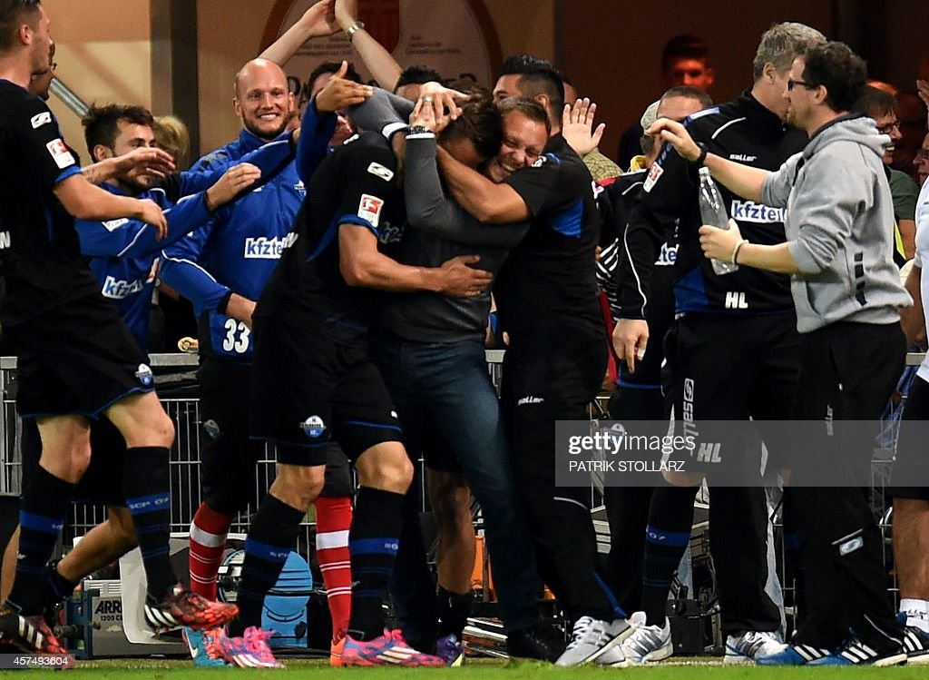 Paderborn´s players celebrate during the German First division Bundesliga football match SC Paderborn 07 vs Eintracht Frankfurt on October 19 2014 in...