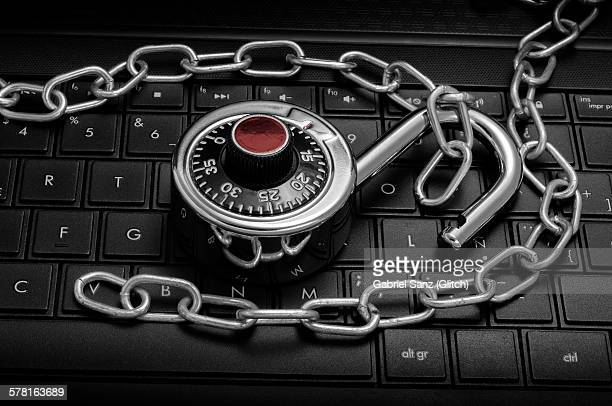 Padlock and chain on keyboard