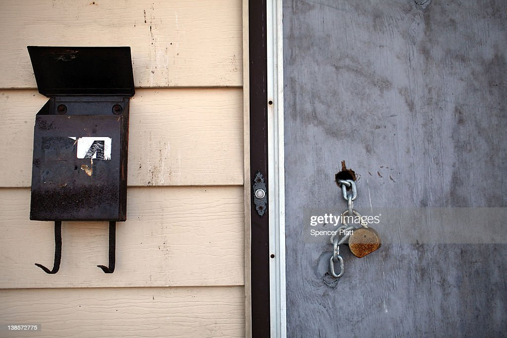 A padlock hangs from a door of a foreclosed home on February 9, 2012 in Islip, New York. A New York State Department of Financial Services Foreclosure Relief Unit van visited Islip to provide individuals who are facing foreclosure with counselors who can assess where homeowners are in the pre-foreclosure or foreclosure process. The mobile unit, which is equipped with computers and communications, looks to slow the number of foreclosures in the state and to provide information about loan modifications available to homeowners under federal law. Islip, which is located in Suffolk County, has the highest foreclosure rate in New York State.