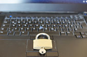 Silver Padlock on computer keyboard. Network Security, data security and antivirus protection PC.