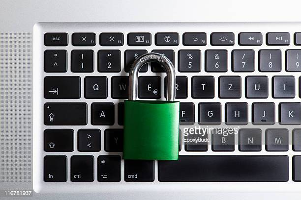 A padlock on top of a laptop keyboard