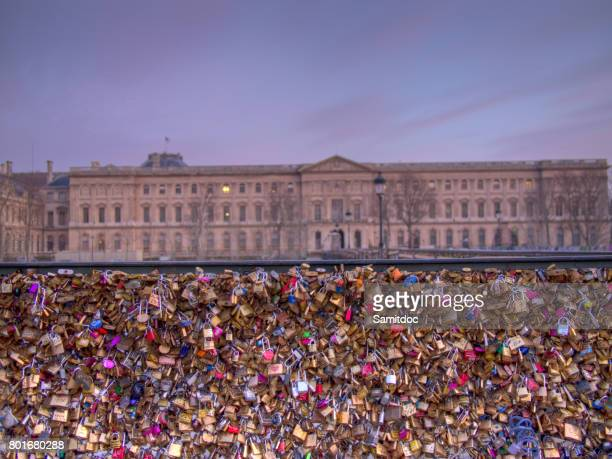 Padlocks at Passarelle des Arts Bridge that symbolize the desire for an eternal love. Over 16000 lockers have been left by couples in love on Passarelle des Arts.Paris,France