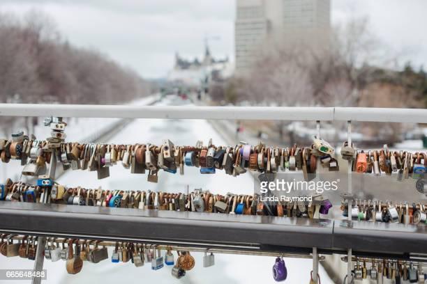 Padlocks attached to a bridge