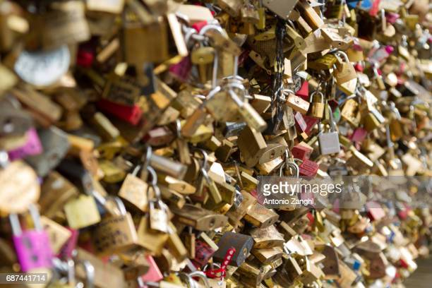Padlocks known as love locks adorn the Pont des Arts bridge that spans the Seine River in Paris