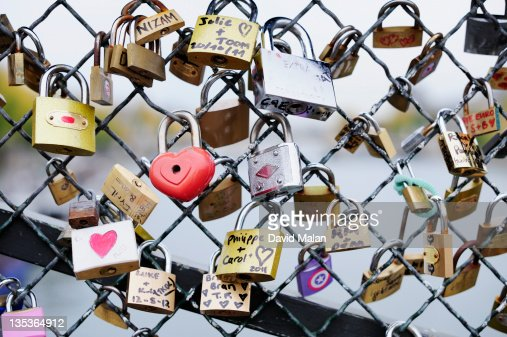 Padlocks on a bridge over the river Seine (Paris) : Stock Photo