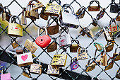 Padlocks on a bridge over the river Seine (Paris)