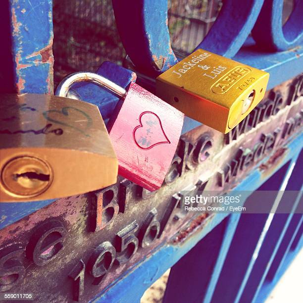 Padlocks On Metal Gate