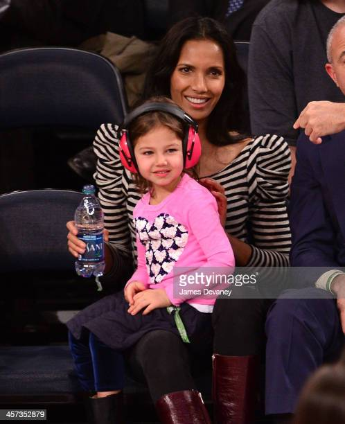 Padma Lakshmi and daughter Krishna LakshmiDell attend the Washington Wizards vs New York Knicks game at Madison Square Garden on December 16 2013 in...