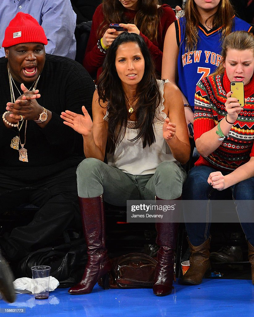 Padma Lakshmi and guest (L) attend the Chicago Bulls vs New York Knicks game at Madison Square Garden on December 21, 2012 in New York City.