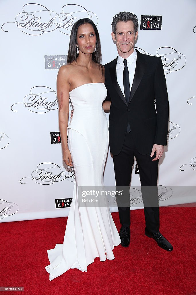<a gi-track='captionPersonalityLinkClicked' href=/galleries/search?phrase=Padma+Lakshmi&family=editorial&specificpeople=201593 ng-click='$event.stopPropagation()'>Padma Lakshmi</a> (L) and Peter Twyman, CEO of Keep A Child Alive attend the Keep A Child Alive's Black Ball Redux 2012 at The Apollo Theater on December 6, 2012 in New York City.