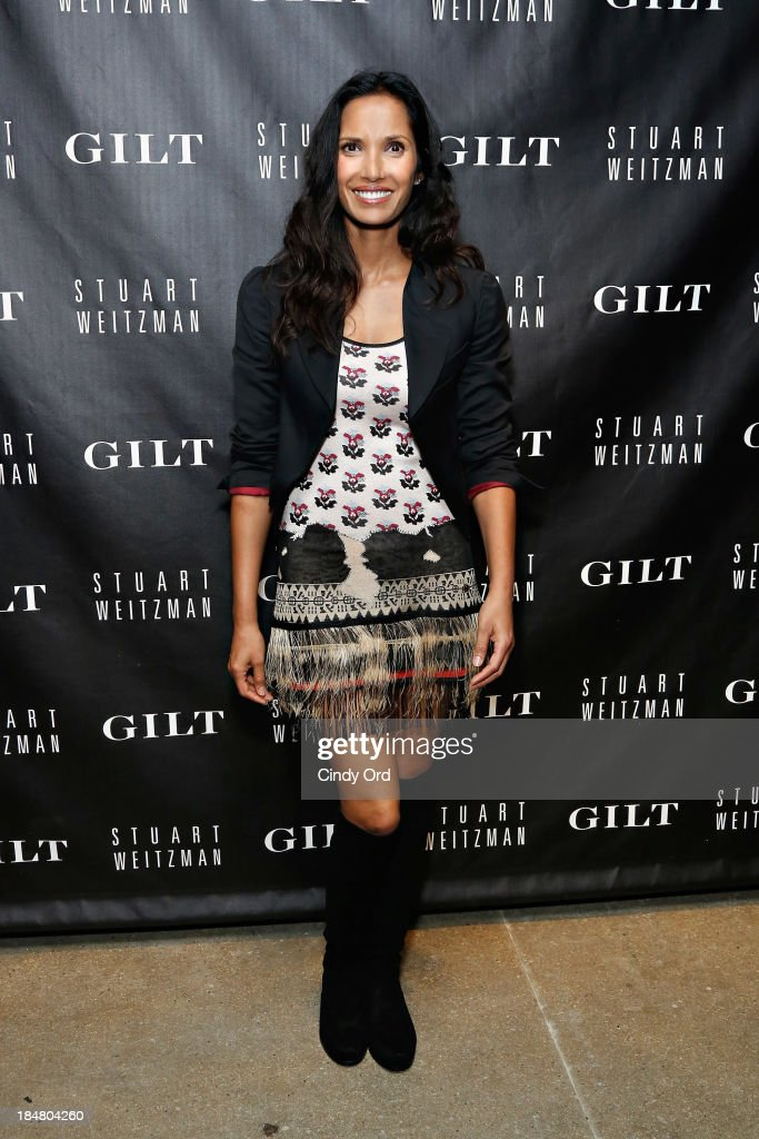 <a gi-track='captionPersonalityLinkClicked' href=/galleries/search?phrase=Padma+Lakshmi&family=editorial&specificpeople=201593 ng-click='$event.stopPropagation()'>Padma Lakshmi</a> attends as Gilt And Stuart Weitzman celebrate the 5050 Boot 20th anniversary on October 16, 2013 in New York City.